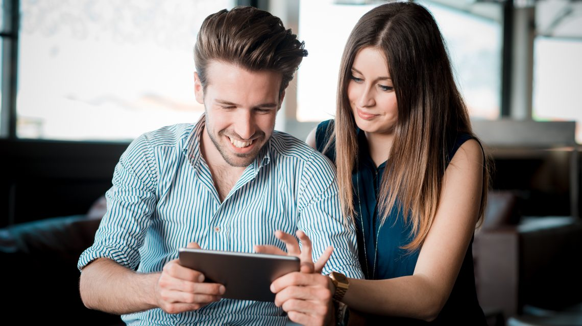 Evanoff Dental - Couple Looking at Tablet - Dental Insurance